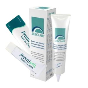Tube and outer pacakage of two creams; Sebclair Dermatola and Promiseb Topical