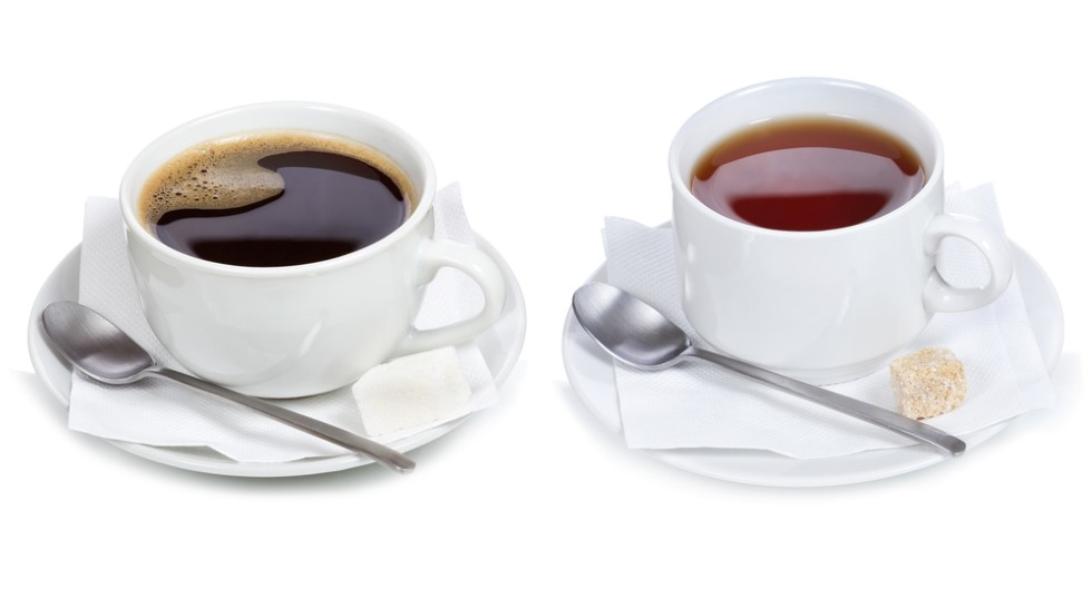 A single cup of coffee and a single cup of tea - shown to represent the fact that it is likely to consume moderate amounts of caffeine-containing beverages with minimal risk of worsening seborrheic dermatitis symptoms